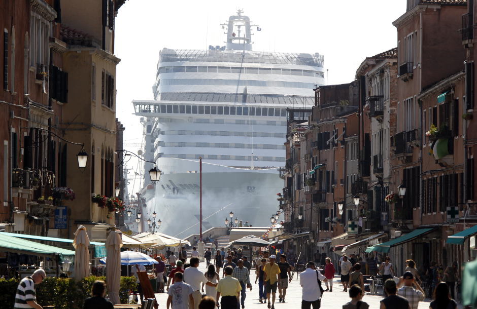 The MSC Divina cruise ship is seen in Venice lagoon June 16, 2012. Environmentalists urged film diva Sophia Loren to help stop a big cruise ship named in her honor from ever entering the Venice lagoon because of potential damage to the city and the lagoon's delicate ecosystem. The MSC Divina (Divine), which the actress christened last month in France, is a 139,500-tonne ship that can carry 3,500 passengers and nearly 1,000 crew. REUTERS/Stefano Rellandini (ITALY - Tags: TRAVEL ENVIRONMENT TRANSPORT) - RTR33Q3V